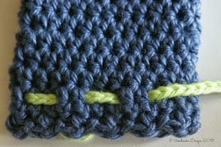 How to weave the tie through the last row of stitches
