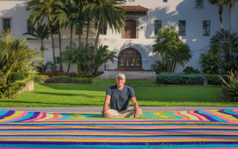 YarnBomber Sets Guinness World Record for largest Granny Square!  Using more than 30 miles of Red Heart Super Saver Yarn!