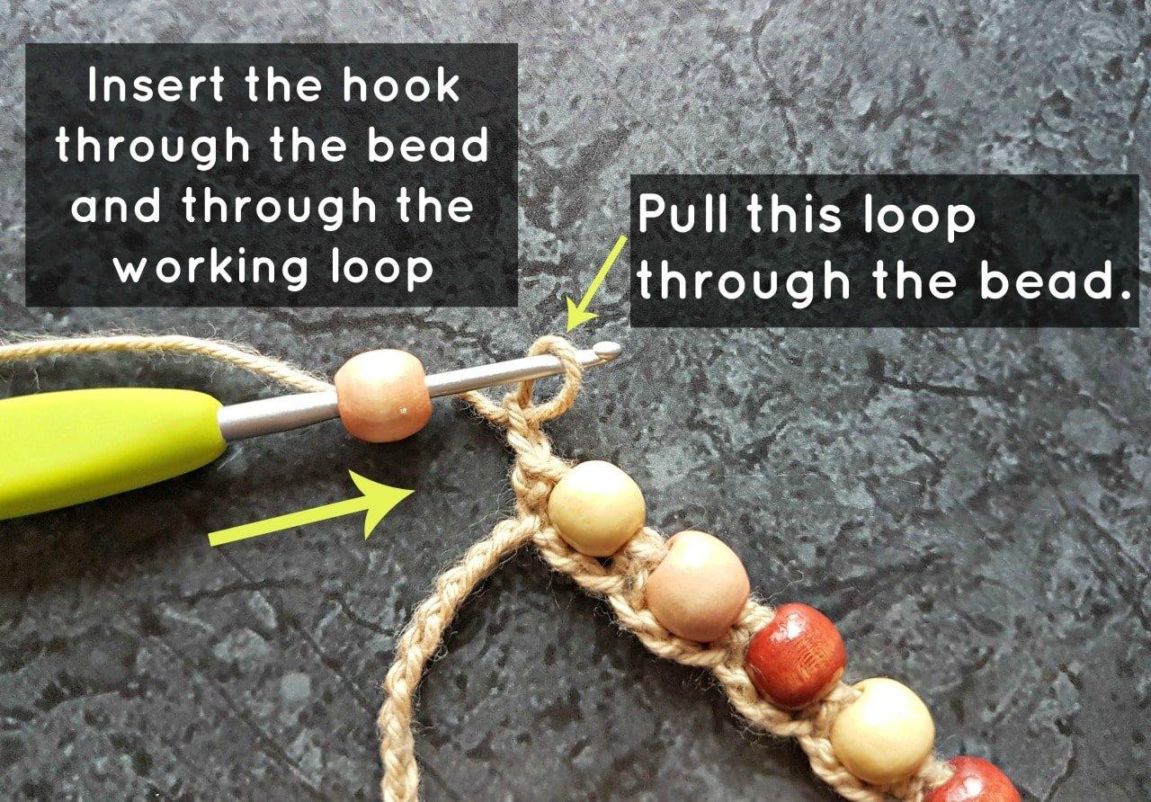 Insert the hook through the bead. Boho Beaded Cuff Bracelet Tutorial. Oombawka Design Crochet.