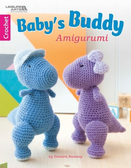 Baby\'s Buddy Amigurumi includes a great collection of little huggable toys which are designed specifically for babies. Choose from friendly dinosaurs, cuddly teddy bears, chubby bunnies, sweet baby dolls, diaper wearing elephants, huggable turtles, soft little sheep and even a set of rattle dumbbells. Learn more about this month's Featured Leisure Arts eBook and enter for a chance to win your very own eBook copy!