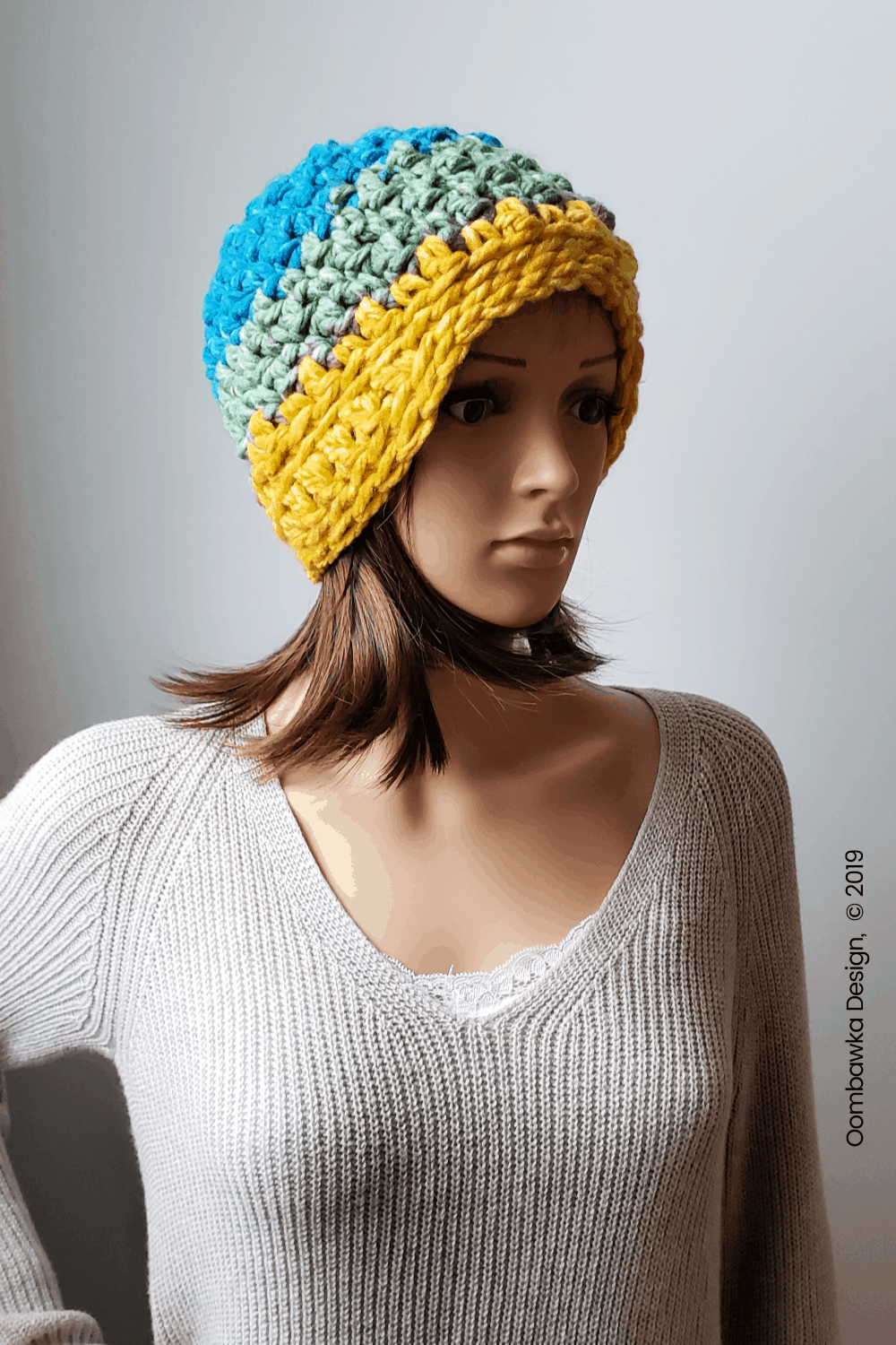 Today I get to share my new Norah Hat Pattern with you! This great project works up SO FAST! Less than 40 minutes from start to finish and less than 1 ball of Super Bulky Weight Yarn! The pattern is available in sizes Child and Adult (small, medium and large). You need a 10 mm (N/P) hook and Bernat POP! Bulky Yarn from Yarnspirations. #yarnspirations #joycreators #hatpattern #crochet #CALCentralCrochet #HolidayStashdown
